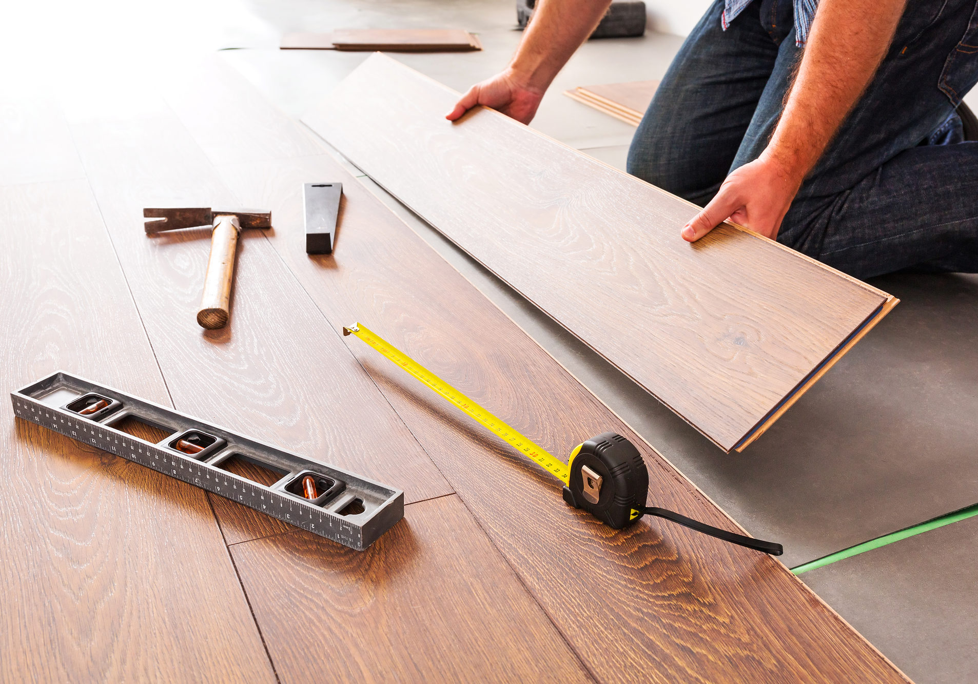 man working on a new flooring